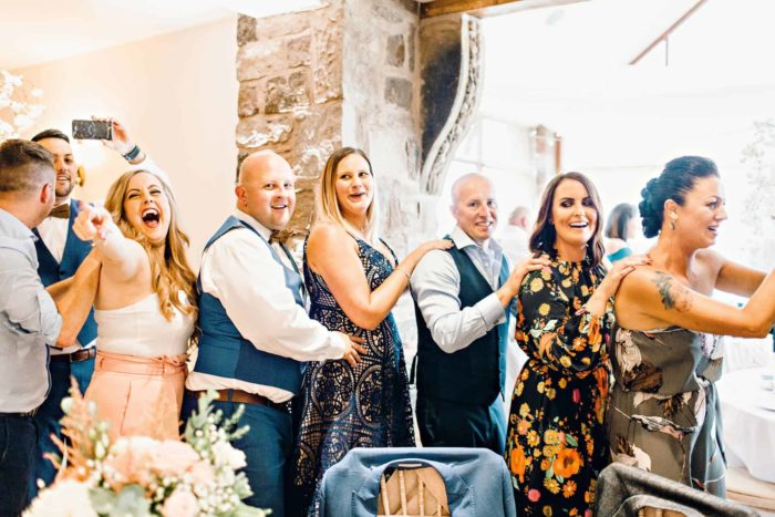 Conga Line at wedding singing waiter