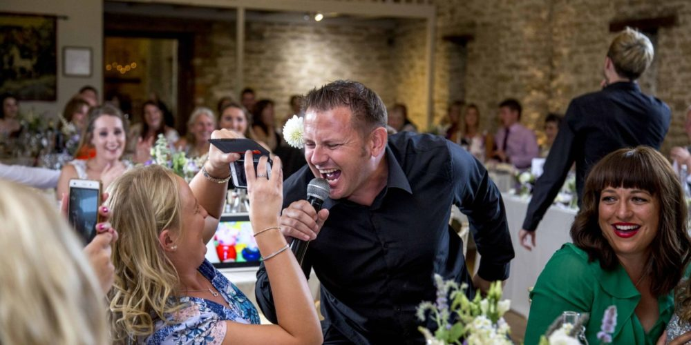 singing waiter being recorded