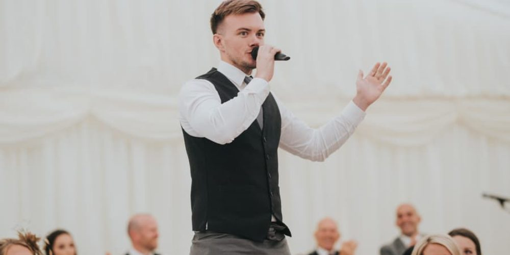 singing waiter mid performance