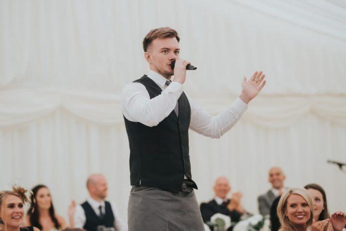 singing waiter mid performance