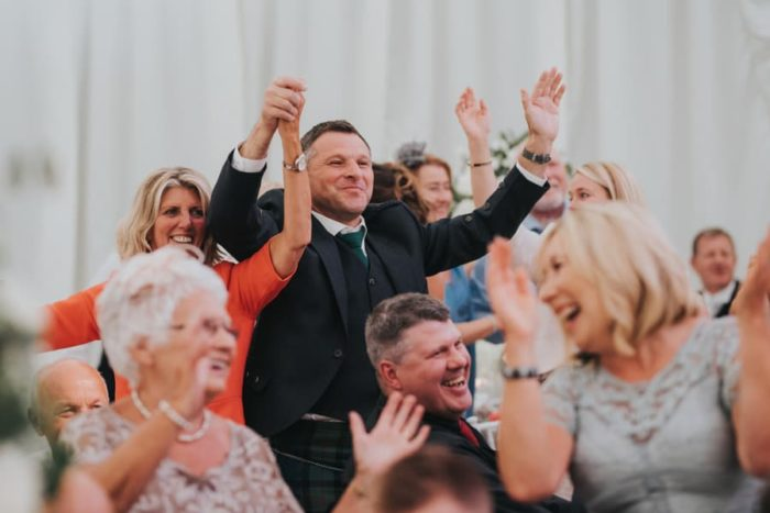 happy wedding dancing to singing waiter