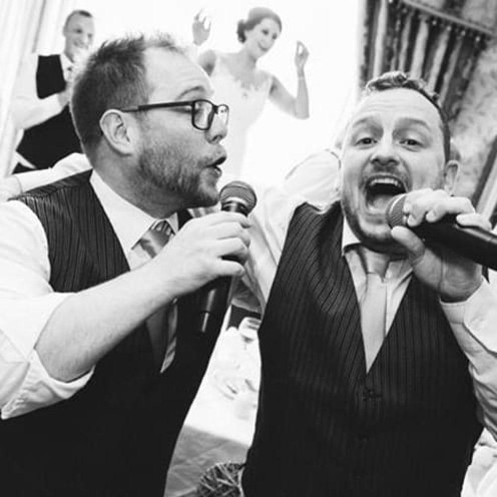 Singing waiters black and white duo