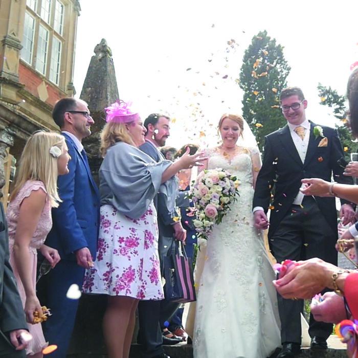 Confetti throw wedding couple videography