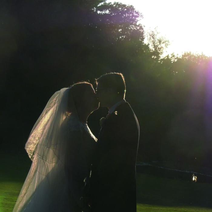 Kissing bride and groom videograpy shot