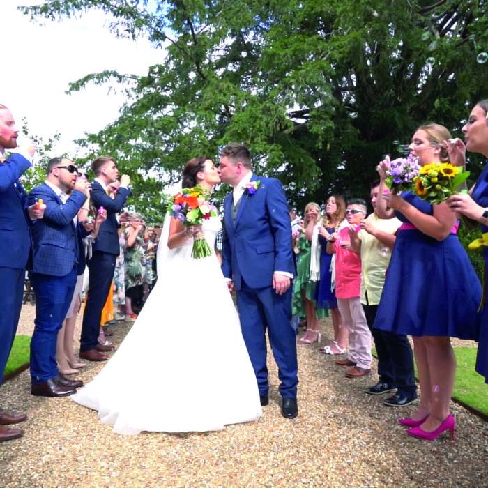 Wedding Videography bubble aisle couple